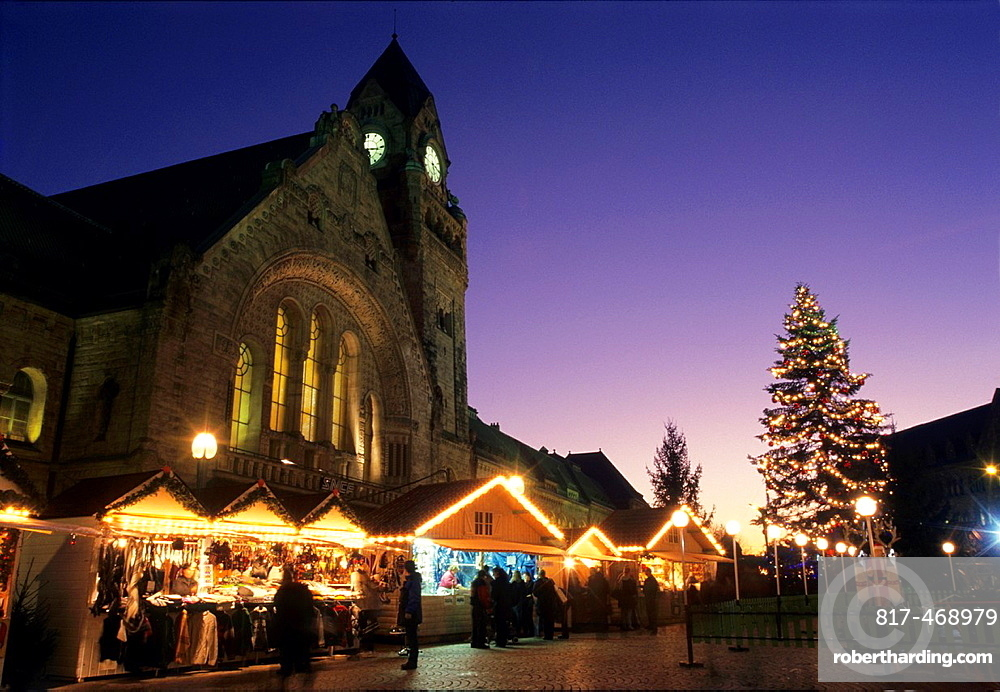 Christmas market on General de Gaulle  place, front of historic railway station building, Metz, Lorraine, France