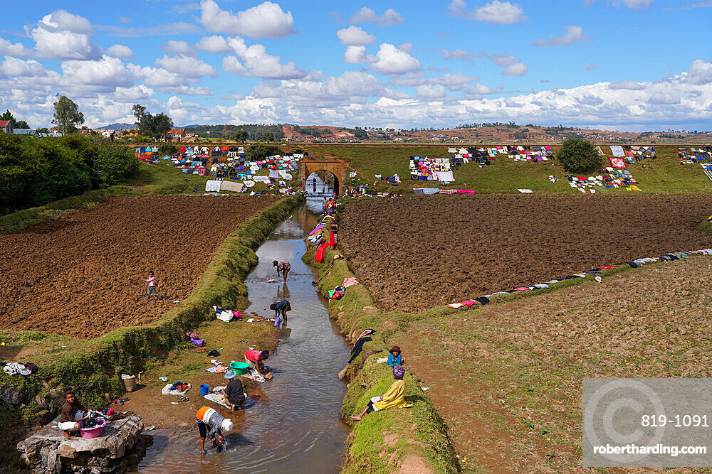 People doing laundry and drying it along the railway, Antsirabe, Central Madagascar