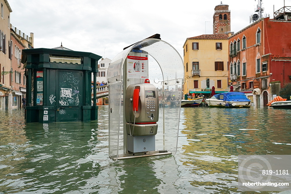 High tide in Venice, november 2019, newsstand and telephone booth at Ponte delle Guglie, Venice, Italy, Europe
