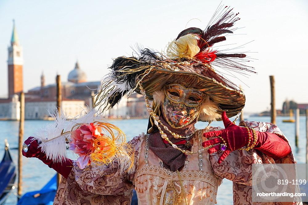 Masks at the Venice Carnival in St. Mark's Square, Venice, Veneto, Italy, Europe