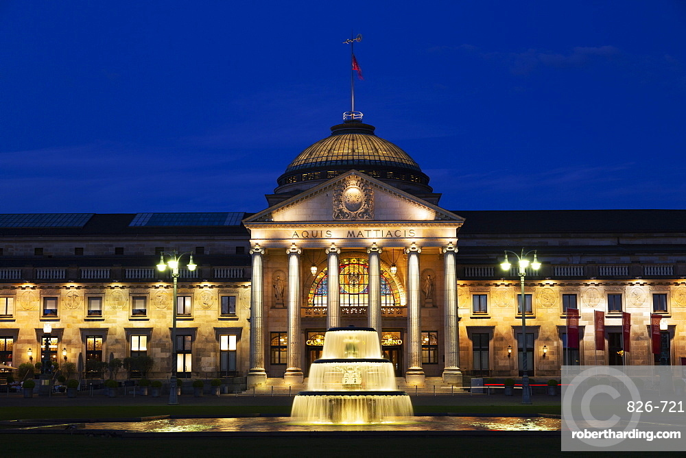 Illuminated fountain, at dusk, on the Bowling Green, in front of the Kurhaus, in Wiesbaden, Hesse, Germany, Europe