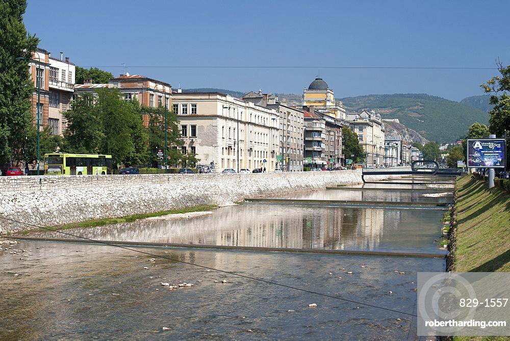 Buildings along Obala Kulina Bana road on the north bank of the Miljacka River in Sarajevo, capital of Bosnia and Herzegovina, Europe