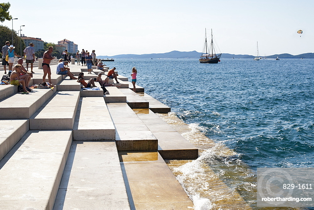 People on the steps of the Sea Organ in Zadar on the Adriatic coast, Croatia, Europe