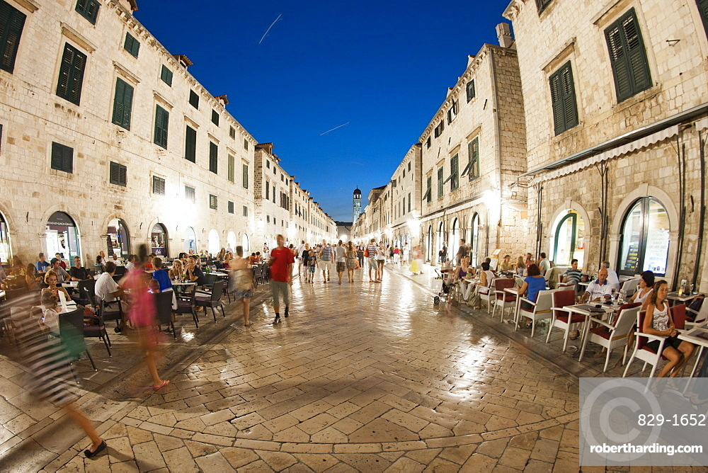 Pedestrians walking at night along Stradun, the main street in the old town in Dubrovnik, UNESCO World Heritage Site, Adriatic Coast, Croatia, Europe