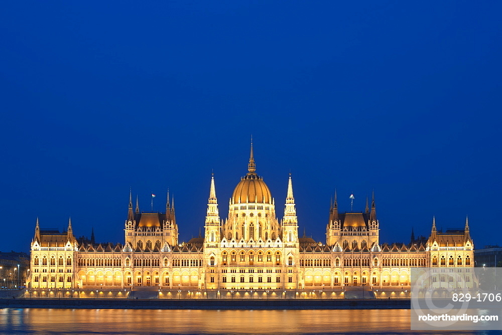 Dusk view of the Hungarian Parliament Building on the banks of the Danube River, Budapest, Hungary, Europe