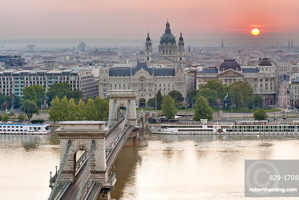Sunrise over city with the Szechenyi Chain Bridge and the dome of St. Stephen's Basilica, Budapest, Hungary, Europe