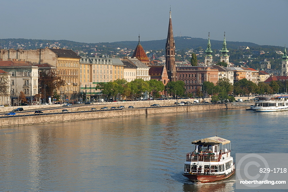 Dawn view of the Danube River in Budapest showing the Buda Reformed Church in the centre and St. Anne's Church on the right, Budapest, Hungary, Europe