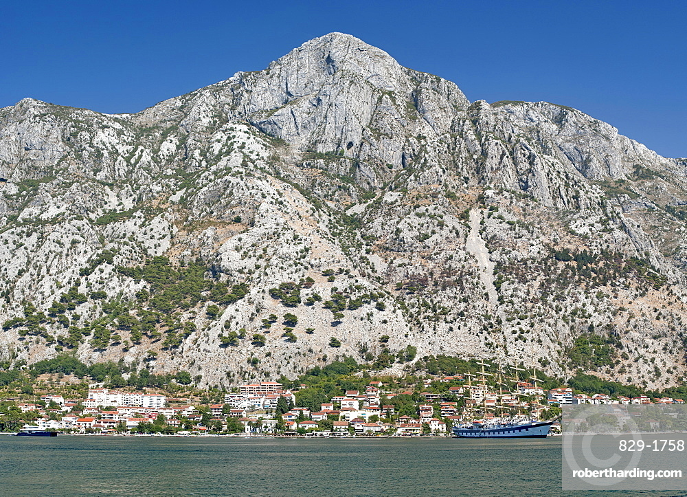 View of the mountains and houses on the edge of Kotor Bay, UNESCO World Heritage Site, Montenegro, Europe