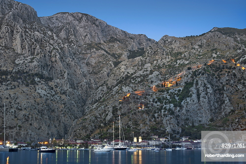 Dusk view of Kotor Bay, Kotor town and the fortifications overlooking the town, UNESCO World Heritage Site, Montenegro, Europe