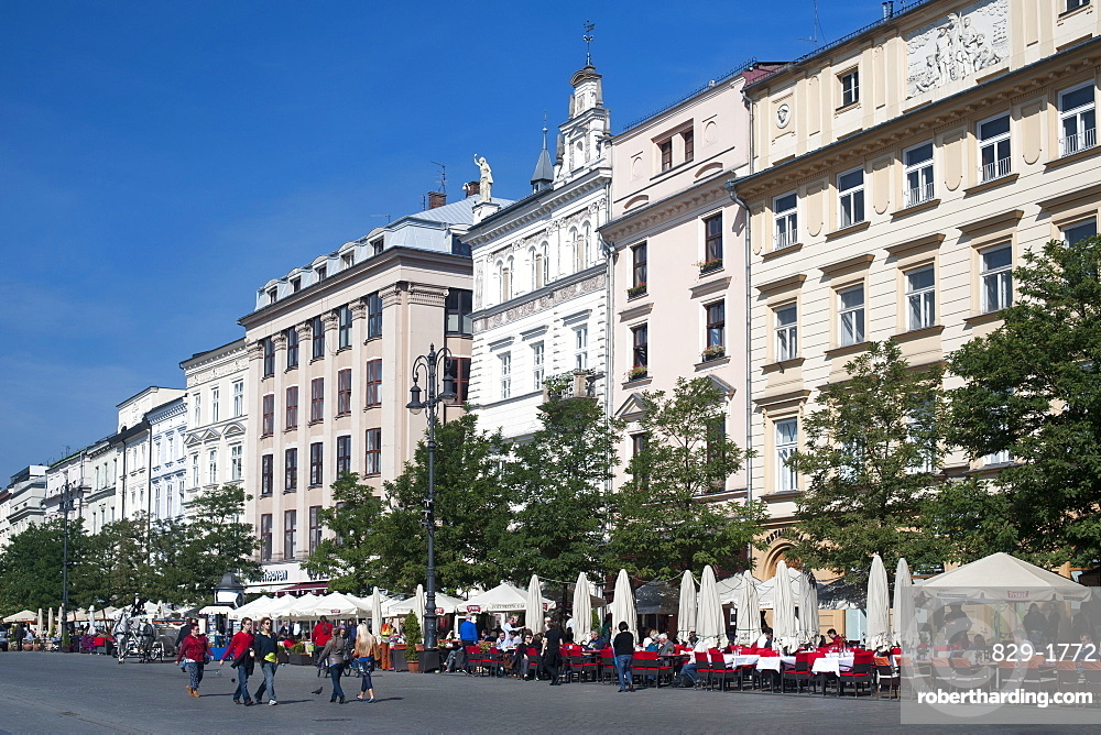 Buildings on Rynek Glowny, the main town square in Krakow in southern Poland, Europe