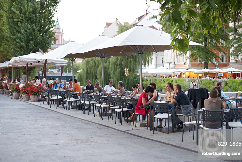 Sidewalk cafes on the banks of the Ljubljanica River in the old town in Ljubljana, Slovenia, Europe