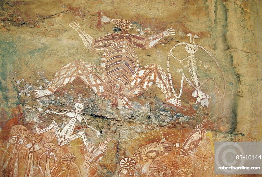 Namondjok (centre) who ate his clan sister, Namarrgon (right) , the Lightning Man and Barrginj his wife (below left) supernatural ancestors at the rock art site at Nourlangie Rock, Kakadu National Park, Northern Territory, Australia