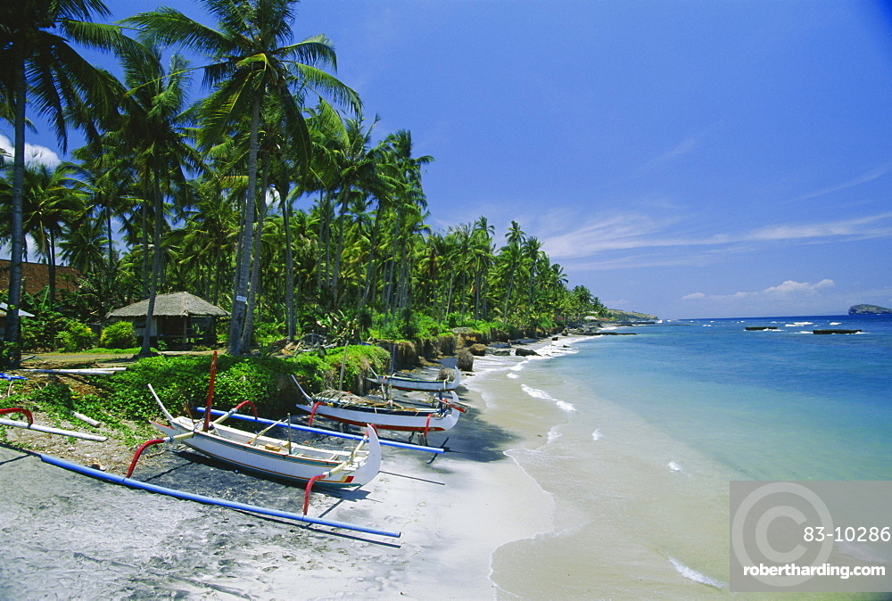 The beach at Candidasa, popular east coast resort which has lost a lot of sand to erosion, Bali, Indonesia, Asia