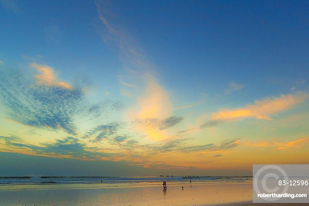 Pacific sunset at popular Playa Guiones surf beach, Nosara, Nicoya Peninsula, Guanacaste Province, Costa Rica, Central America