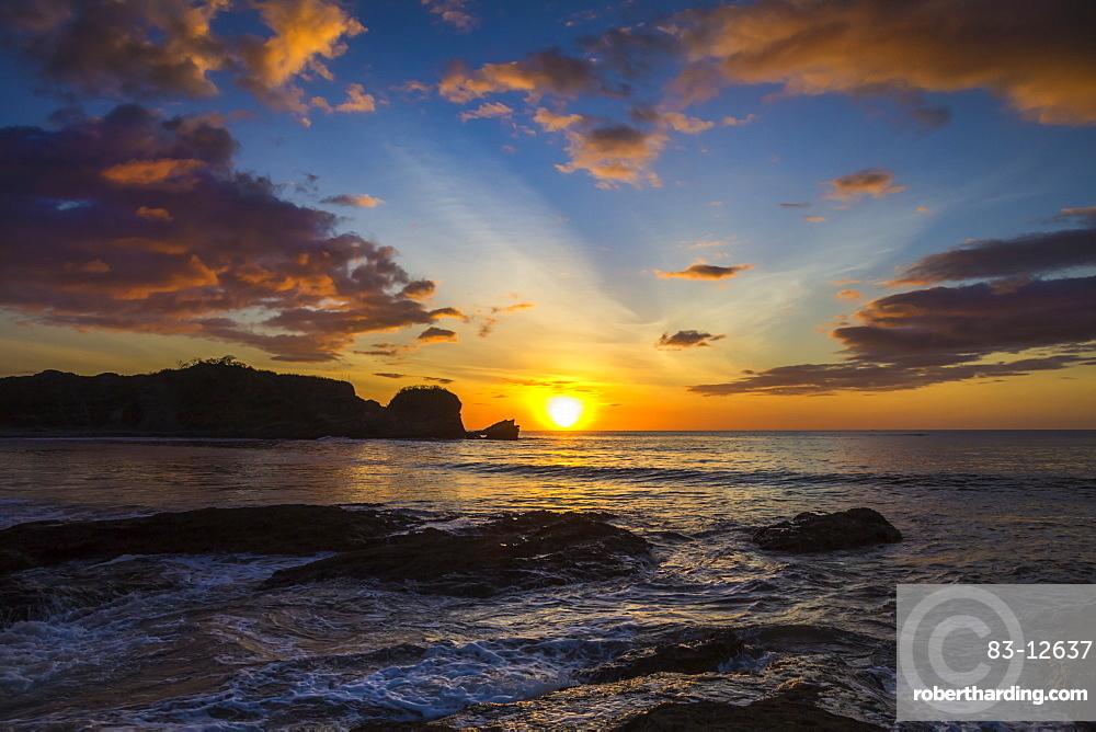 Sunset by the southern headland of beautiful Playa Pelada beach, Nosara, Nicoya Peninsula, Guanacaste Province, Costa Rica