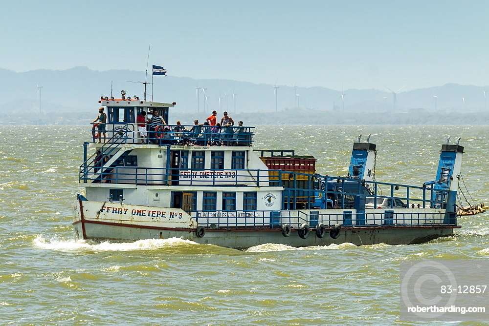 Ferry heading from San Jorge to Omotepe Island, carrying tourists, locals and  freight, Isla Omotepe, Lake Nicaragua, Nicaragua, Central America