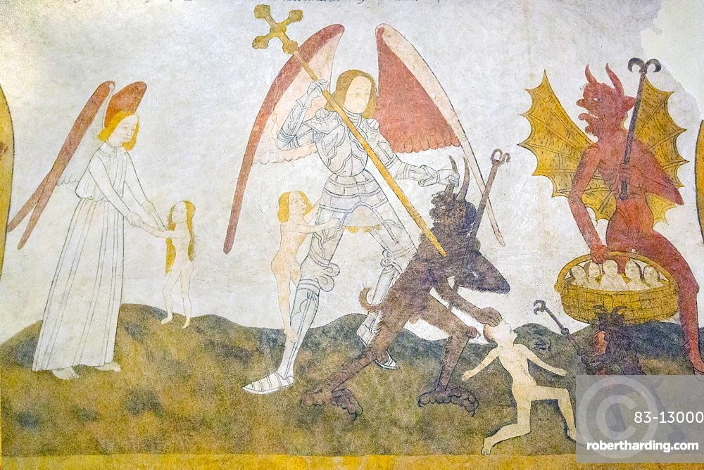 The 15 century Last Judgement fresco in St. Eutrope church in this historic Dropt Valley village, Allemans-du-Dropt, Lot-et-Garonne, France, Europe