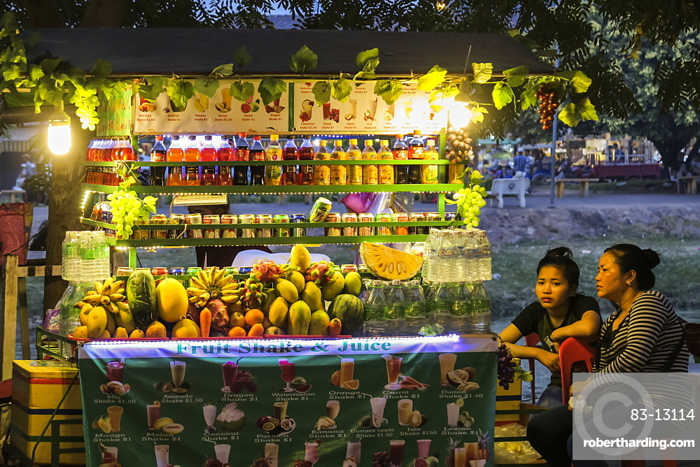 Fruit and drink stall at the Art Center Night Market by the Siem Reap River in this north west tourist town, Siem Reap, Cambodia, Indochina, Southeast Asia, Asia