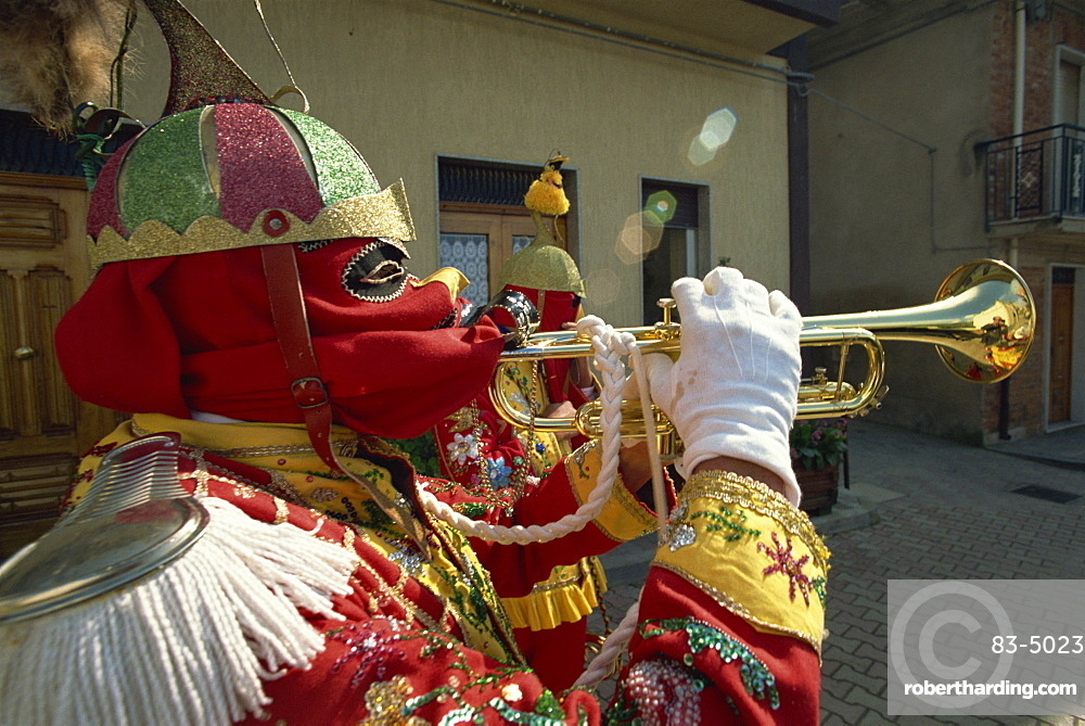 Trumpet player in red costume and mask celebrates the Feast of the Jews, just before Easter, in the Lombard village of San Fratello, north Sicily, Italy, Europe