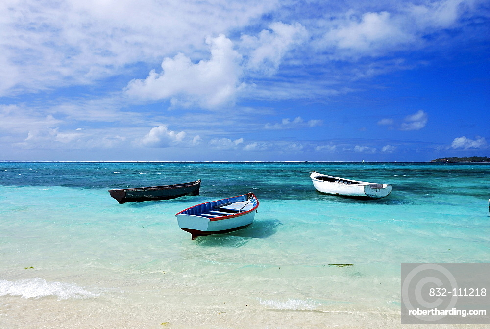 Three fishing boats bobbing in turquoise waters, Mauritius, Africa