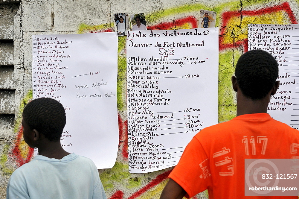 Residents viewing a list of victims of the earthquake in January 2010 on a house wall, Fort National district, Port-au-Prince, Haiti, Caribbean, Central America
