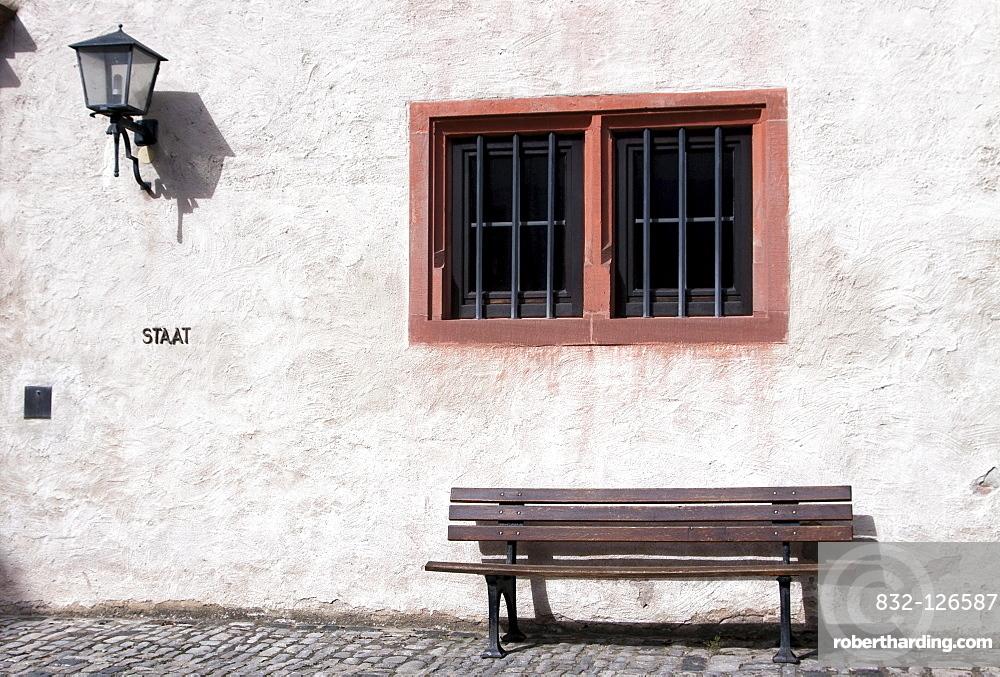 Old wooden bench below a window, Wuerzburg, Bavaria, Germany, Europe