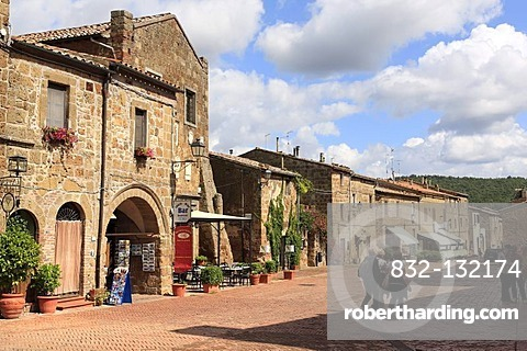The Palazzo Pretorio, 13th century, on the left, street and tourists in medieval village of Sovana, Province of Grosseto, Tuscany, Italy, Europe