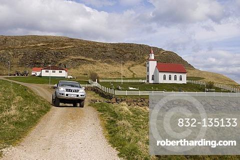 Off-road vehicle, Helgafell church near Stykkisholmur, Snaefellsnes Peninsula, Iceland, Europe