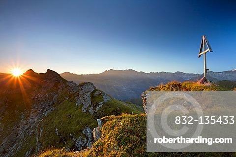 Mountain cross and sunrise in the canton of Glarus, Swiss Alps, Switzerland, Europe