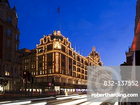 Harrods Department Store at dusk with traffic trails, Knightsbridge, London, England, United Kingdom, Europe