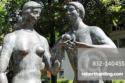 Sculptures of Adam and Eve in front of the Spitalmuehle mill, courtyard of the 'Heiliger Geist' Hospital, Schwaebisch Gmuend, Baden-Wuerttemberg, Germany, Europe