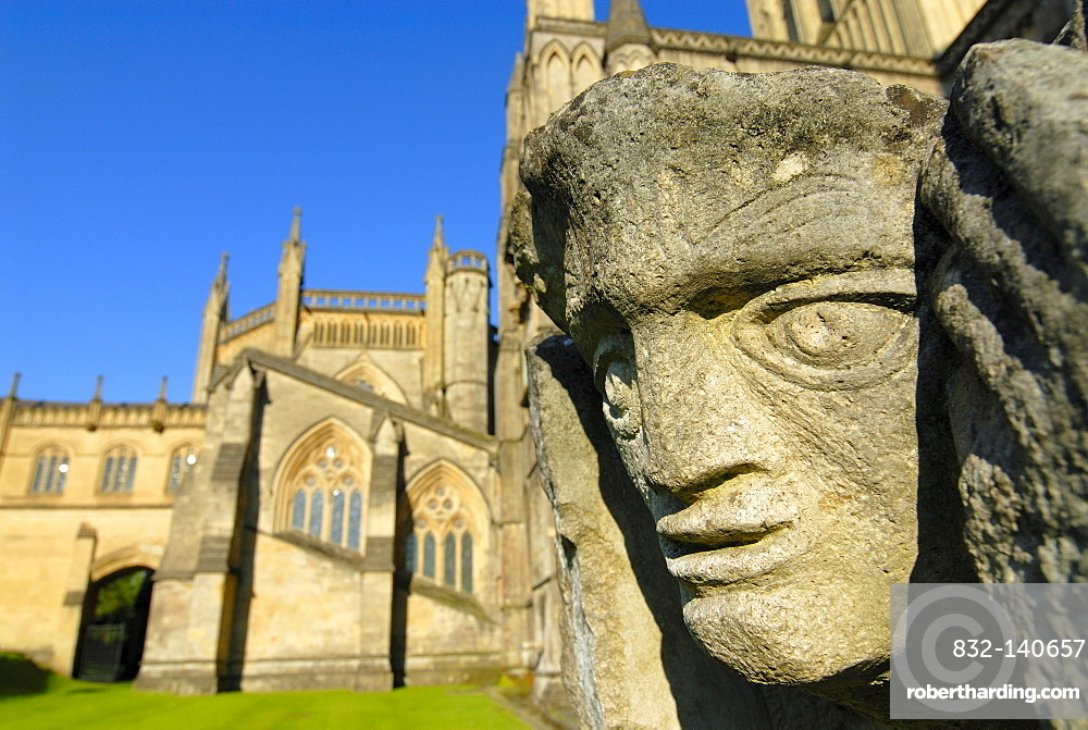 Stone face on Wells Cathedral, Wells, Somerset, England, United Kingdom, Europe
