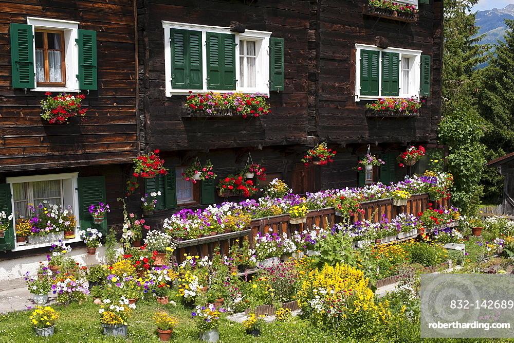Cottage garden in front of a Valais Renaissance house, Geschinen, canton of Valais, Switzerland, Europe