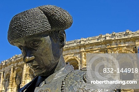 Arenes de Nimes Roman amphitheatre and bullfighter statue, Nimes, Gard, Bouches-Du-Rhone, France, Europe