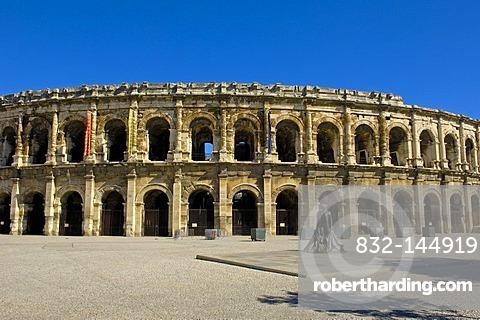 Arenes de Nimes Roman amphitheatre and bullfighter statue, Nimes, Gard, Bouches-Du-Rhone, France, Europe