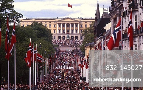 Main street Karl Johan with flags and people in front of the royal palace, celebration of the National day, May 17, Oslo, Norway, Europe