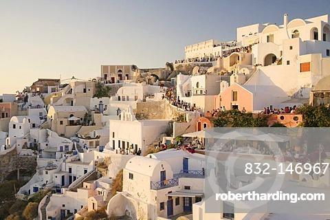 Tourists gathered to watch the sunset, Oia, Santorini, Cyclades, Greece, Europe