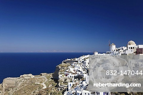 White houses with windmills and church, Oia, Santorini, Cyclades, Greece, Europe