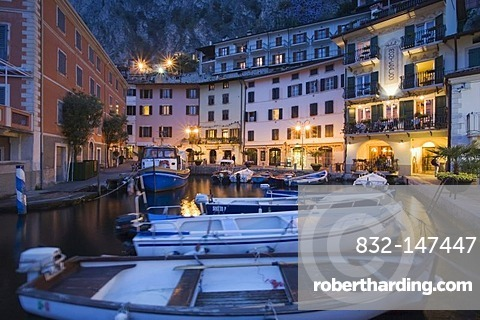 Illuminated promenade at the port of Limone in the evening, Lake Garda, Lombardy, Italy, Europe