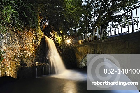 Small illuminated waterfall at the outflow channel of the power station below the mill and next to the Rheinfall waterfalls, Canton Schaffhausen, Switzerland, Europe