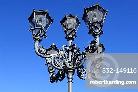 Old five-armed cast-iron decorative lantern against blue sky, Rhena, Mecklenburg-Western Pomerania, Germany, Europe