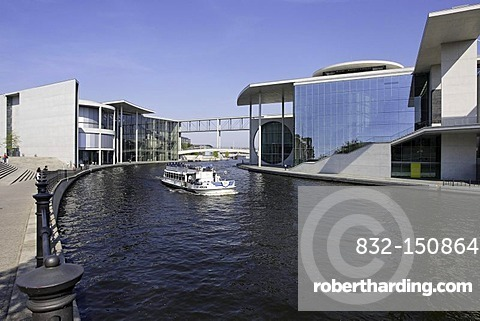 Tourist boat on the Spree River passing the Marie-Elisabeth-Lueders-Haus building, Berlin, Germany, Europe