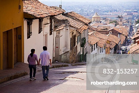 Couple walking down sloping street, Bogota, Colombia, South America
