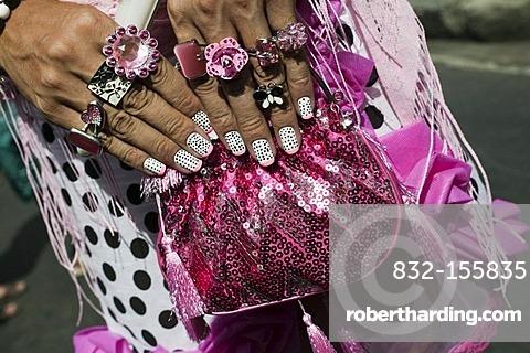 Close-up of transvestite's hands with painted finger nails, rings and handbag, Banda de Ipanema Parade, Carnival in Rio de Janeiro, Brazil, South America