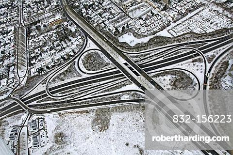 Aerial, A40, B236 highway, interchange, Stadtkrone-Ost industrial park in snow, Ruhrgebiet region, North Rhine-Westphalia, Germany, Europe