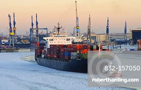 Container ship on the Elbe river in the wintery port of Hamburg, Germany, Europe