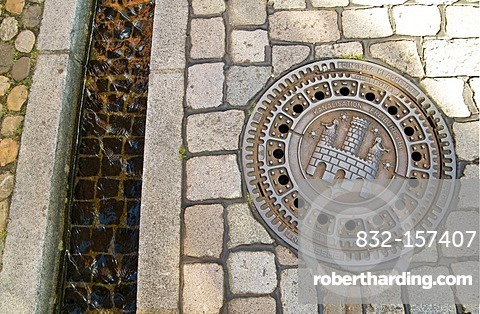 Manhole cover with Freiburg coat of arms and Freiburger Baechle brook, Freiburg, Baden-Wuerttemberg, Germany, Europe