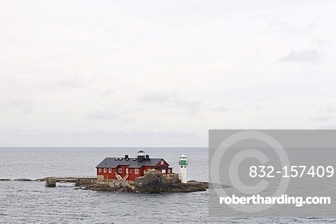 House and lighthouse on a skerry island off Gothenburg, Sweden, Scandinavia, Europe