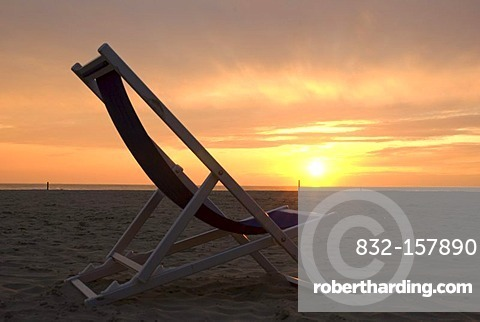 Deckchair and sunset on a beach of the Versilia, Lido di Camaiore, Riviera, Tuscany, Italy, Europe