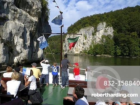 People on the deck of a passenger ship, gap of danube river, near Weltenburg, Altmuehltal Nature Park, Bavaria, Germany, Europe